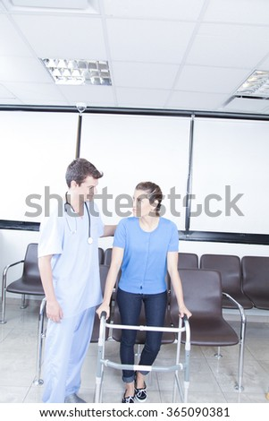 Male nurse helping a woman