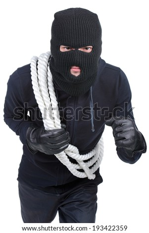 Male offender from Balaklava in the head with a rope. Isolated on white background - stock photo