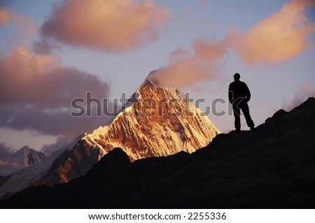 Male on the sunrise in high mountain - stock photo