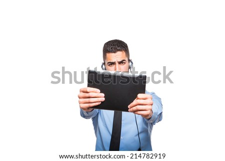 male operator, handsome man playing in formal wear with headsets and a tablet