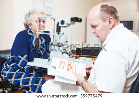Male ophthalmologist or optometrist at work - stock photo