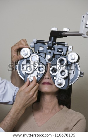 Male optometrist examining patient
