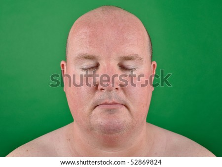 male over weight on green screen - stock photo