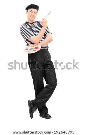 Male painter holding a paintbrush and leaning against a wall isolated on white background - stock photo