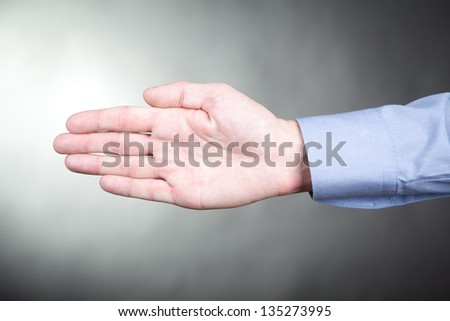 Male palm faced to camera on neutral background