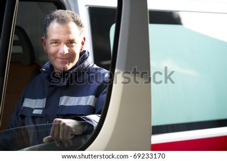 Male paramedic driving ambulance - stock photo