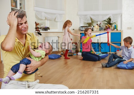 male parent in stress or confusion state of children bad manners behaviour - stock photo