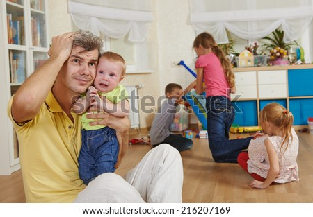 male parent man frustrated and upset from children behaviour - stock photo