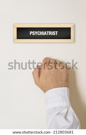 Male patient knocking on Psychiatrist door for a medical exam. - stock photo