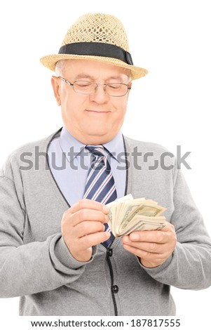Male pensioner counting money isolated on white background - stock photo