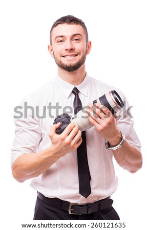 Male photographer focusing and composing an image with his professional digital SLR camera pointing the lens directly at the viewer, upper body isolated on white - stock photo
