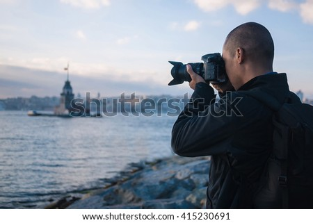 Male photographer in Istanbul, Turkey, taking photo of Maiden's  - stock photo