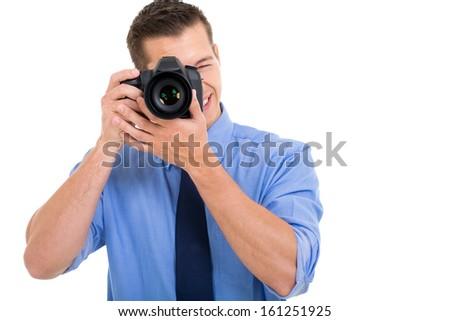 male photographer taking photo on white background - stock photo