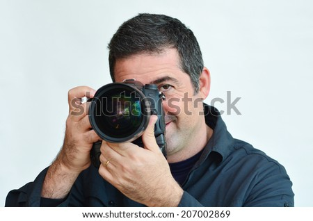 Male photographer taking photos with DSLR digital camera.White background copy space . Concept photo photography, hobby and work. - stock photo