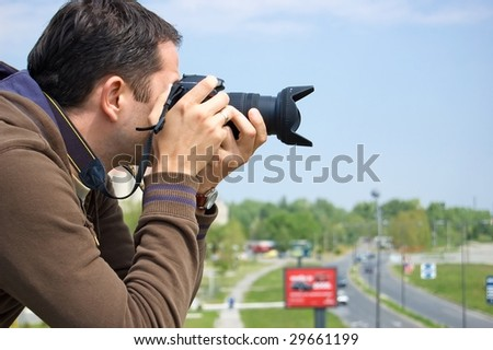 Male photographer waiting for a good shoots. - stock photo
