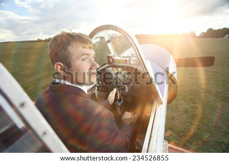 Male pilot a small plane - stock photo
