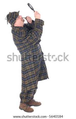 Male police officer dressed up as Sherlock Holmes investigating crime scene with magnifying glass. - stock photo