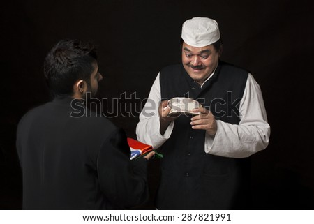 Male politician smiling while holding bribe money - stock photo