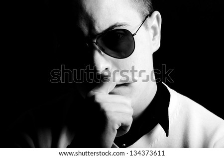 Male portrait in black and white. Shoot in low key technique - stock photo