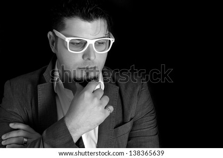 Male portrait in low key and black and white - stock photo