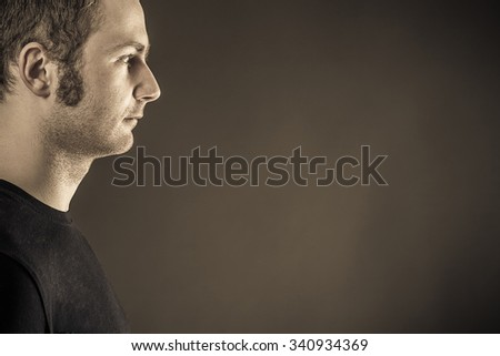 Male portrait on dark background. Close up - stock photo