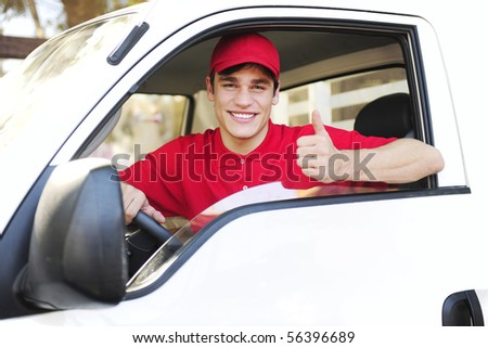 male postal delivery courier in a van showing thumb up hand sign