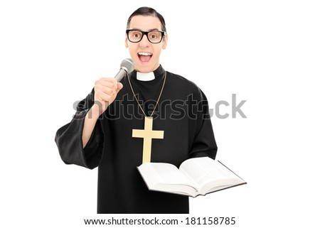 Male priest reading a prayer on microphone isolated on white background
