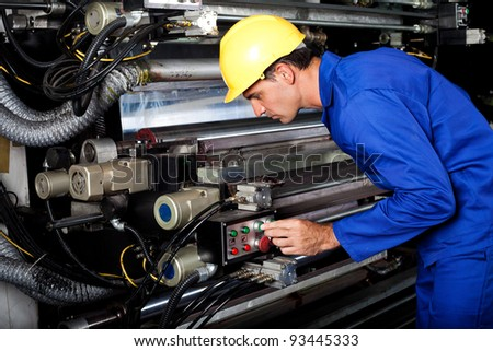 male printer running modern industrial printing machine - stock photo