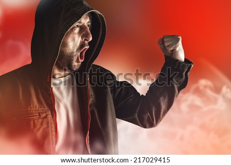 Male Protester Shouts at Riot Act on the Streets. - stock photo