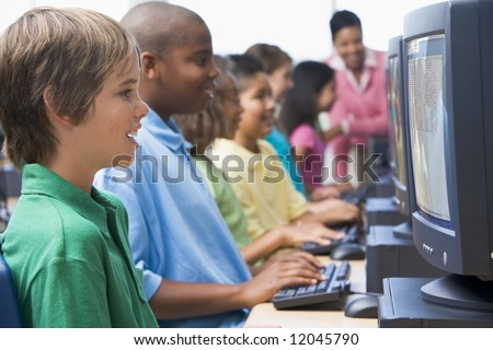 Male pupil in elementary school computer class