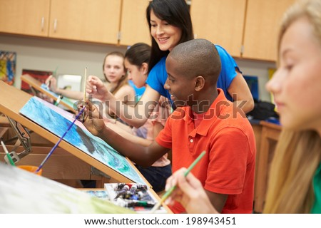 Male Pupil In High School Art Class With Teacher - stock photo