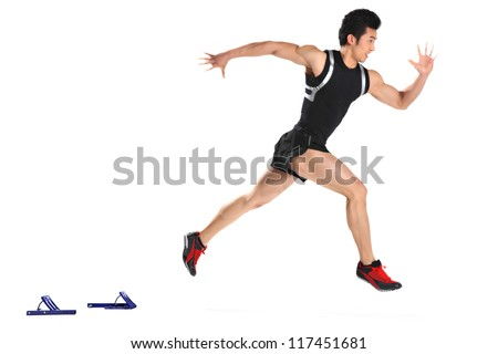 Male runner in starting blocks, close-up