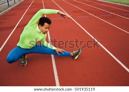 Male runner stretching before workout