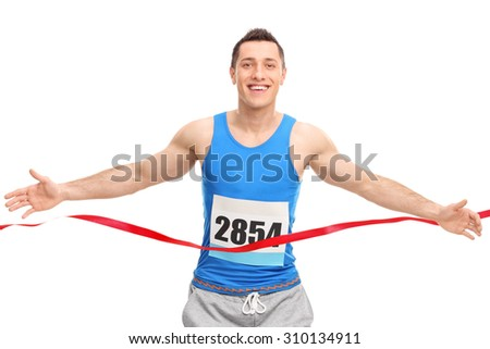 Male runner with a race number on his chest, crossing the finish line isolated on white background - stock photo