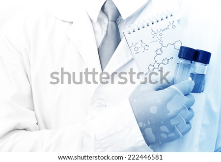 Male scientist holding test tubes in laboratory room.. - stock photo