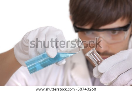 male scientist with two flasks - focus on the hands