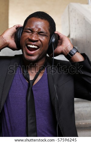 male screaming listening to dj headphones - stock photo