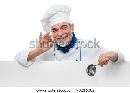 Male senior chef presenting. Isolated on white background