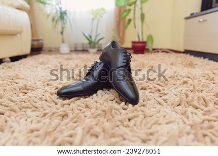 male shoes on carpet at home - stock photo