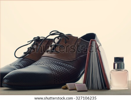 Male shoes, perfume and cufflinks - stock photo