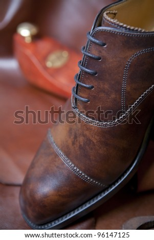 Male shoes with shoemaker tools - stock photo
