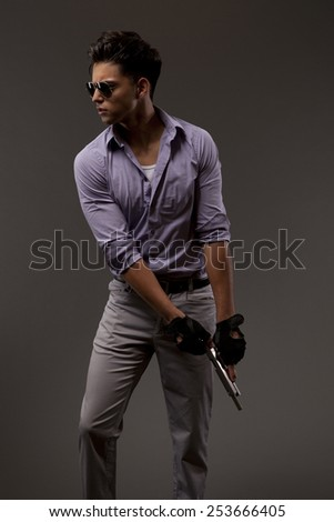 male shooter or contractor chambering a round in handgun - stock photo