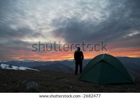 Male silhouette on sunrice - stock photo