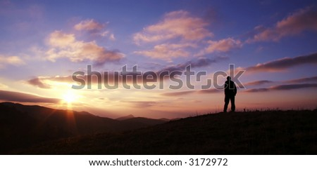 Male silhouette on sunrise background