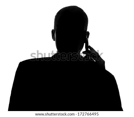 Male silhouette with mobile phone - stock photo