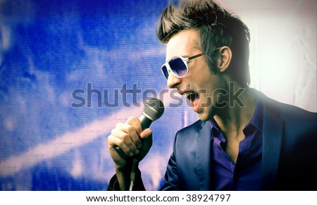male singer with microphone - stock photo