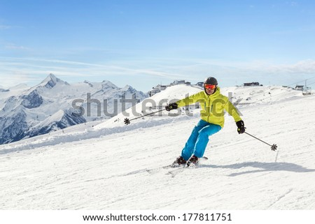 Male skier in the austrian alps - stock photo