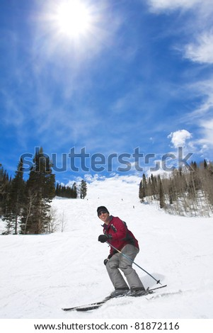 Male Skier laughing while enjoying his ski vacation - stock photo