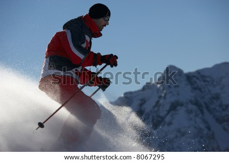 male skier with mountains at background