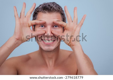 male smiling making funny expression - stock photo